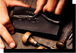 Hand engraving the slate image